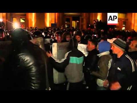 Pro-Russian demonstrators confront Ukrainian riot police in front of regional govt building