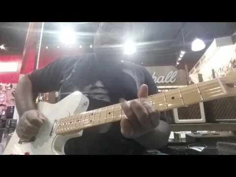 Playing a Fender Telecaster at Sam Ash Musical instruments in Las Vegas, Nevada