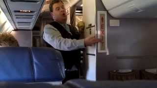 HILARIOUS! Funny Flight Attendant Does Safety Demo on United Express!