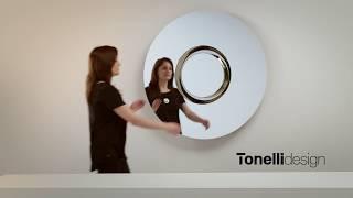 Ozma è uno specchio a parete circolare e concentrico con cerchio ce...