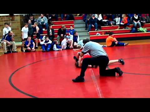Clayton Taylor wrestling for New Hampton Chickasaws 7th grade