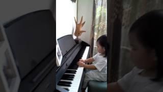 Lexi explores the piano