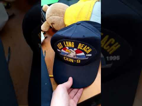 Holding a USS Long Beach Hat for 1.5 Seconds