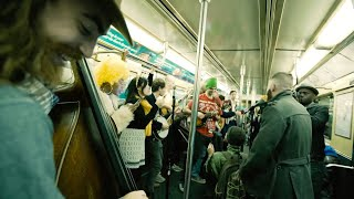 Band Perform Queen On NYC Subway