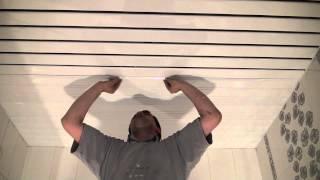 Технология сборки реечного потолка, вставляем распорные планки.