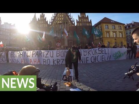 Polish anti-immigrant protesters burn photo of Angela Merkel
