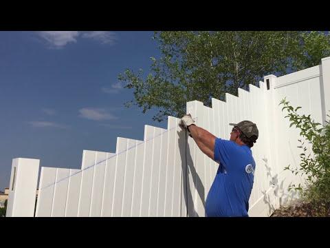 installing vinyl fence hill 1