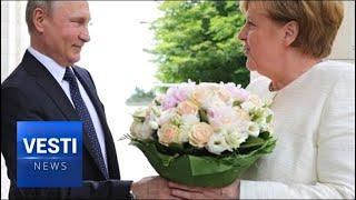 SCANDAL: German Media SHOCKED That Putin Offered Merkel Flowers Instead of Handshake