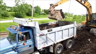 CAT 315D & Ford LTL Dump Truck