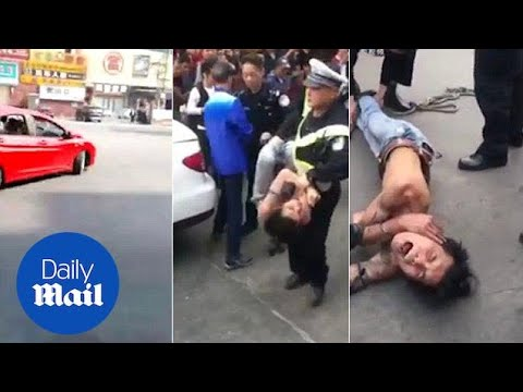 Drifter arrested after police fire two shots in south China - Daily Mail