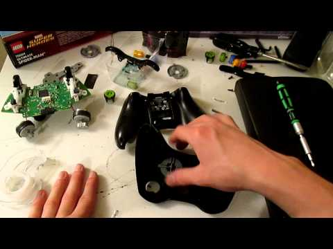How to take apart a xbox 360 controller with a flat head screw driver