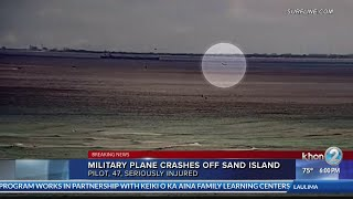 Video shows pilot ejecting from military aircraft prior to crash off Sand Island