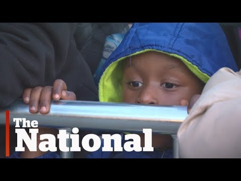 Asylum Seekers from Haiti Pouring Across Border Into Quebec