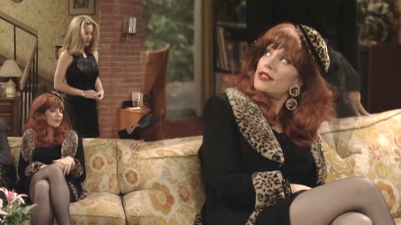 Peggy wearing a short black dress with black pantyhose - Married With Children  s10e03