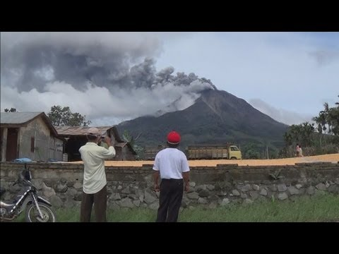 Volcano eruption: Hot ash shoots half a mile into the air at Mount Sinabung