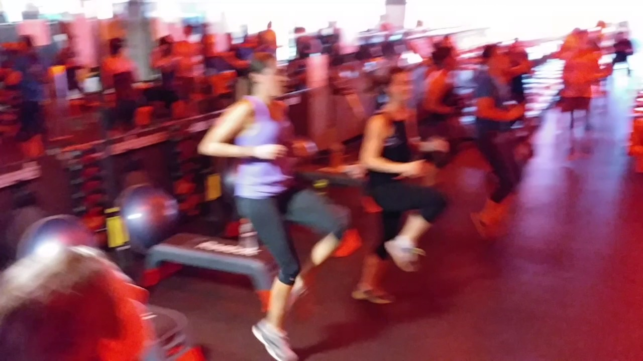 Orangetheory Fitness Broomfield High knees with Broomfield Personal Trainer Michelle