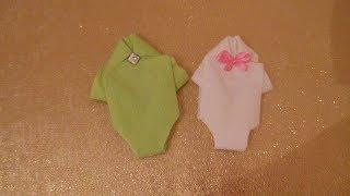 شكل 2 : طريقة طي مناديل ورقية على شكل لبس بيبي لإستقبال مولود جديد أو للسبوع