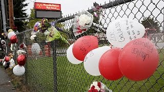 Students struggle to come to terms with fatal shooting at US high school