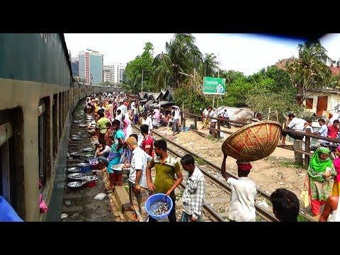 Dhaka bound up Kishoregang Express Train crossing Tejgaon Slum area