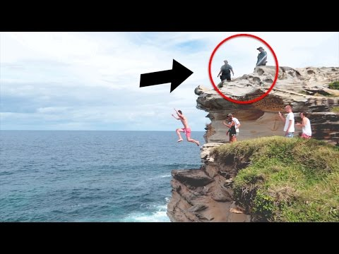 jumping off huge cliff in front of cops