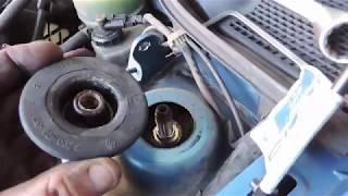 Comment changer les coupelles d'amortisseurs HS  de la CLIO 2 Phase ||