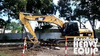 Caterpillar 320D Loading Old Asphalt Fragments into Fuso Dump Truck - Full Movie