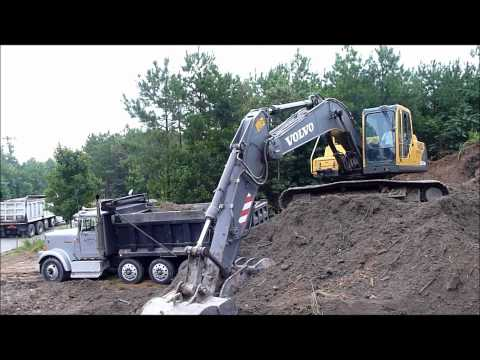 Volvo EC210 Excavator Rocking Out Trucks
