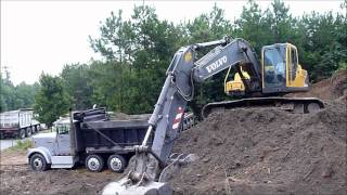 Volvo EC210 Excavator Rocking Out Trucks