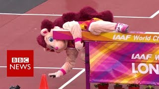 Hurdle proves too much for athletics mascot Hero  BBC News