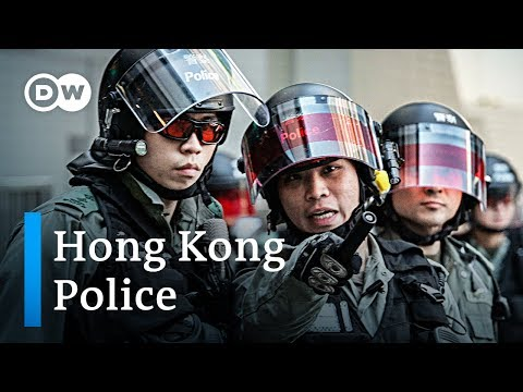 Hong Kong police officers speak out against protesters | DW News