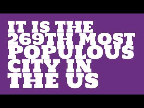 How does the population of Columbia, MO compare to Manhattan?