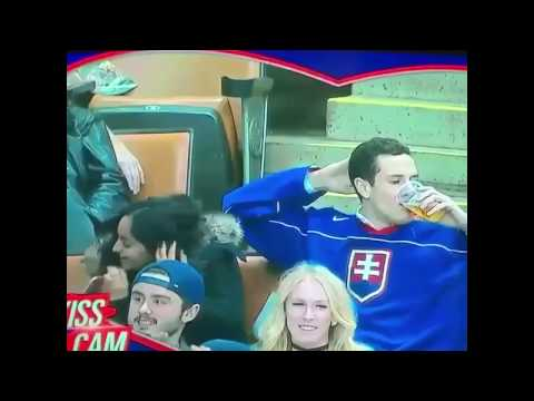 Hockey SLOVAK fan kisses beer then chugs it instead of kissing woman next to him on Kiss Cam