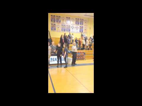 Medomak Valley High School students sing national anthem