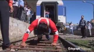 Strongman pulls '100 tonne' train up an incline