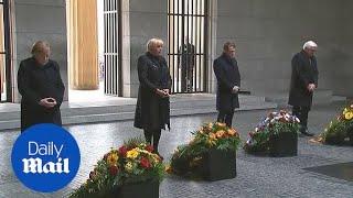 Macron and Merkel pay their respects at Berlin war memorial