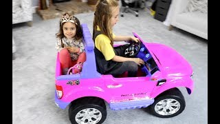 driving pink power wheels ride on car