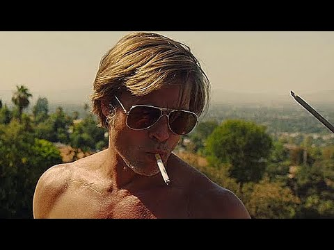 Brad Pitt climbs a roof ONCE UPON A TIME IN HOLLYWOOD