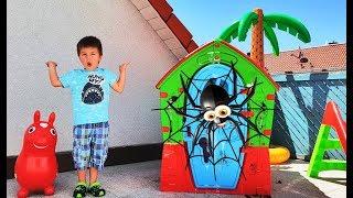 Richard and Dominika repairing children's playhouses