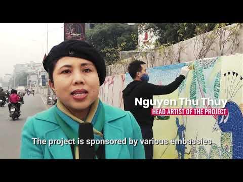 Hanoi artists extend ceramic makeover of riverside street
