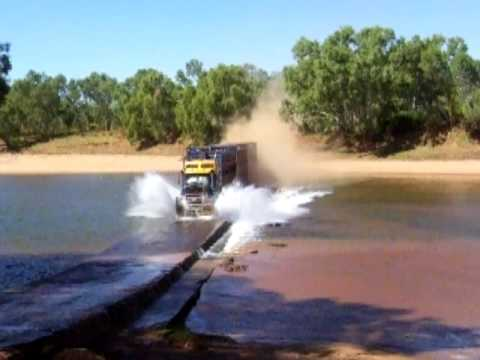 Thumbnail: Road Train going flat-out over a river crossing - Western Australia