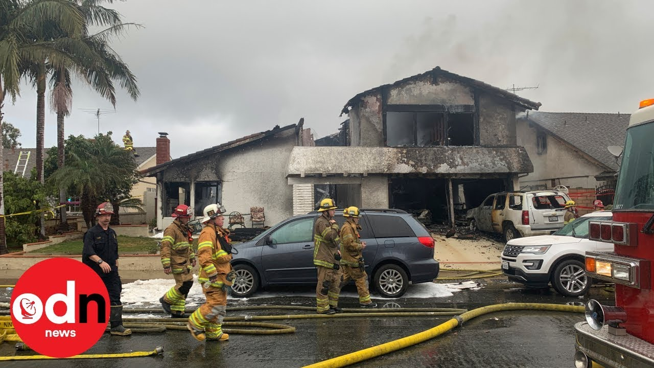 Five killed after plane crashes into house