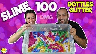 MIXING 100 BOTTLES OF GLITTER INTO A GIANT SLIME!! Mezclamos 100 botes de purpurina en nuestro slime
