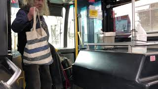 Homeless man not wearing face mask in bus