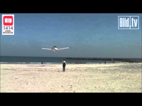 plane hits fat guy on beach