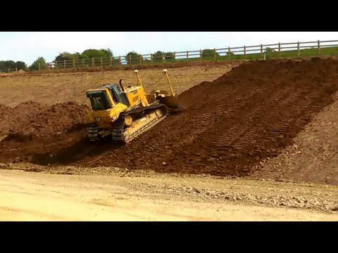 CAT D6N LGP dozer with Trimble 3D GPS pushing topsoil