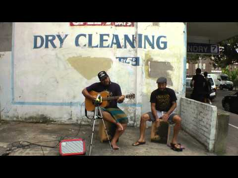 Jamie Allensworth and Anthony playing a Rockbox cajon at Manly beach Australia