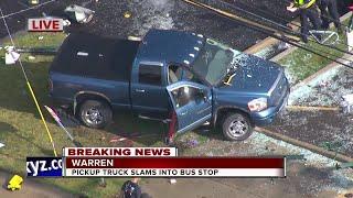 Pickup truck slams into Warren bus stop