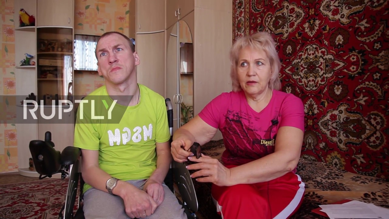 mother  and  son Russian Russian mother carries wheelchair-bound son up and down stairs for 18 years