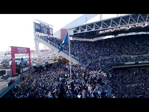 Steve Largent raising the 12th man flag at the Seahawks-Buccaneers game