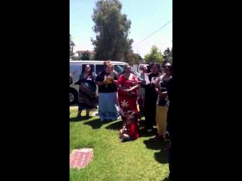 Family singing to Joseph while he goes to his final resting